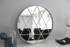 this round mirror looks refined and chic but was hacked for a couple of bucks
