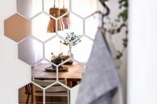 use IKEA HONEFOSS mirror tiles instead of a regular mirror in your entryway to get a cool effect