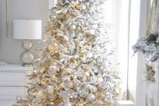 02 a beautiful flocked Christmas tree with white and metallic ornaments is always a very cool idea for a winter wonderland feel