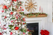 03 a chic farmhouse Christmas tree with red and white ornaments, a plaid ribbon, snowflakes and foliage plus berries is wow