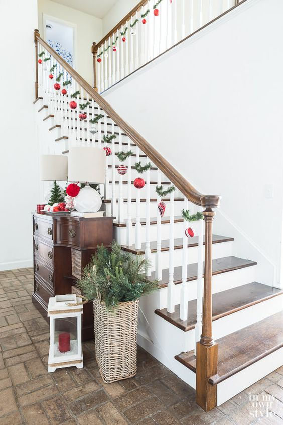 lovely Christmas railing decor with red and silver ornaments and fir twigs is a bold and easy idea to try