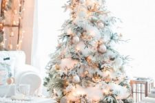 lovely almost all-white flocked christmas tree decor with shiny details