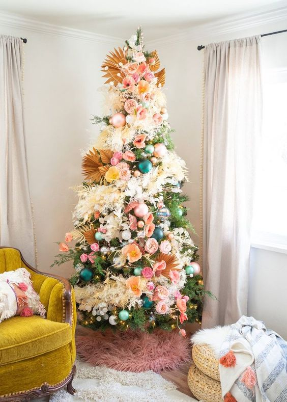 a gorgeous floral Christmas tree with dried fronds, grasses and lights plus a pink faux fur skirt is a very bold and jaw dropping idea