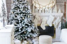 07 a frozen Christmas tree with metallic ornaments, knit stockings and stools and a faux fur throw for creating a winter wonderland feel
