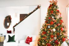 a glam christmas tree in an almost white room