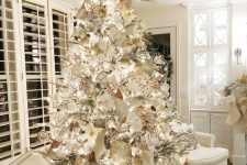 08 a winter wonderland Christmas tree – a flocked piece with white, silver and gold ornaments, fabric blooms and ribbons