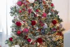09 a lovely Christmas tree with lights, foliage, red and red plaid Christmas ornaments plus plaid gift boxes under the tree