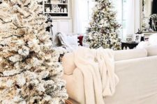 09 create a winter wonderland feel with just some flocked trees with lights in baskets and white textiles – that's easy