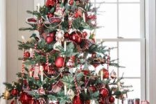 12 a vintage Christmas tree with candy canes, red ornaments, candles, beads is beautiful, chic and very refined