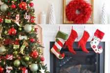 15 bright and fun Christmas tree decor with oversized and whimsical ornaments, lights, stars and stockings, bright stockings and a red wreath
