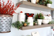 17 beautiful farmhouse Christmas decor with a red runner, faux greenery and berries, bells and a gold deer head on top