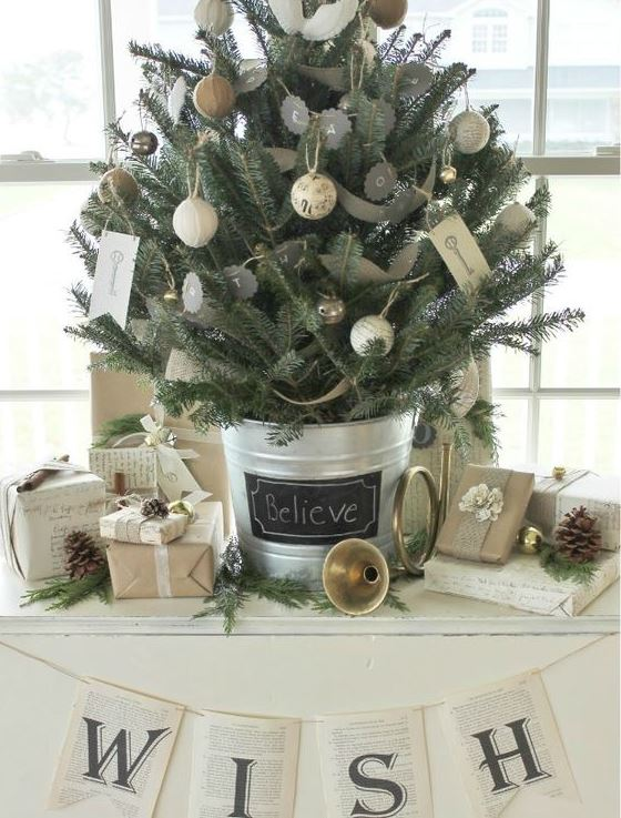 a farmhouse Christmas tree with chalkboard, yarn and burlap ornaments and in a bucket with a chalkboard tag on it is very cozy and chic
