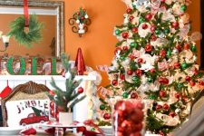 22 red and green Christmas tree decor with white ribbons and lights, plaid runners, red and green ornaments and bells on the table