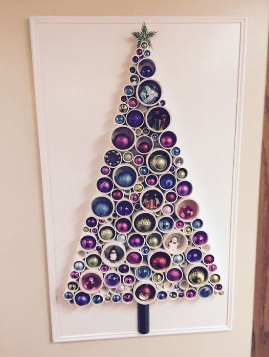 a PVC pipe Christmas tree with colorful ornaments inserted for decor is a cool alternative to a usual Christmas tree