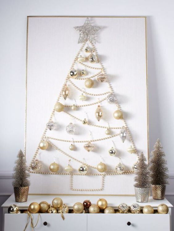 a refined wall-mounted Christmas tree of beads, gold and silver ornaments and a silver vine star topper