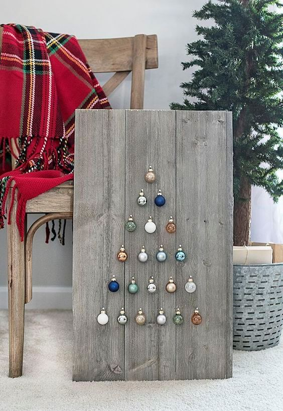 Step by step instructions on how to build a simple, rustic Shiplap Ornament Display.  A great addition to your rustic, farmhouse holiday decor.  livelaughrowe.com