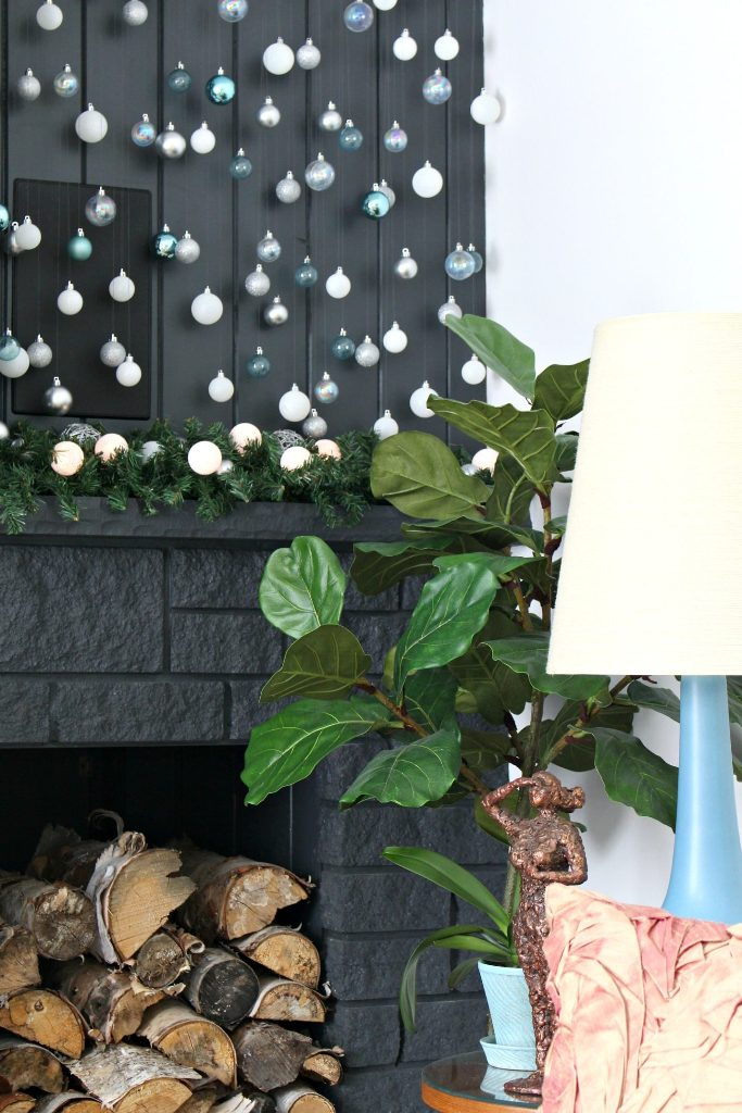 Christmas wall decor with cascading ornaments of light blue, aqua and white color is a gorgeous modern decor idea