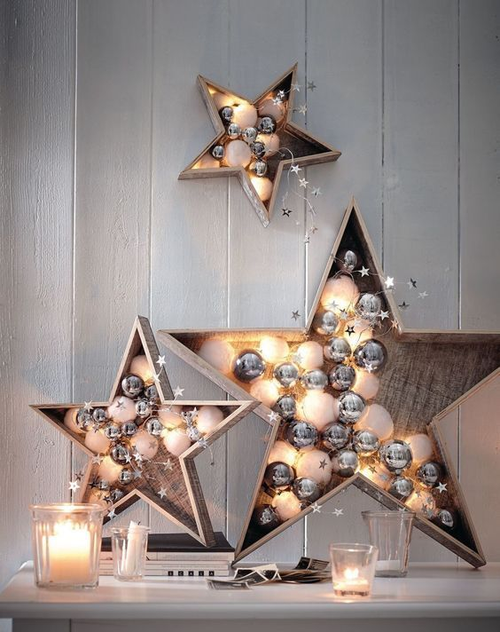 plywood stars filled with white and silver ornaments, stars and lights are gorgeous holiday decorations to rock