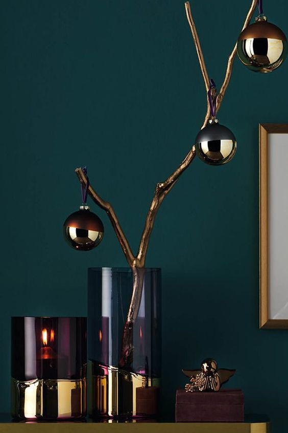 stylish two-tone vases and gilded branches with elegant two-tone ornaments are chic and refined Christmas decor