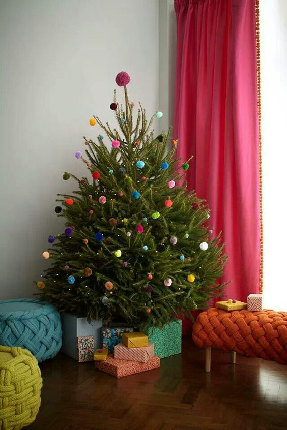 a Christmas tree decorated with colorful pompoms all over is a veyr fun and cool idea that won't cost you anything