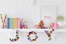a banner with JOY letters made completely of colorful pompoms is a fun and cool idea to rock for Christmas