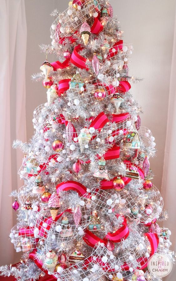 a bold and fun Christmas tree in silver, with hot pink and red ribbons, snowy pompom ribbons, colorful ornaments and ice cream ones