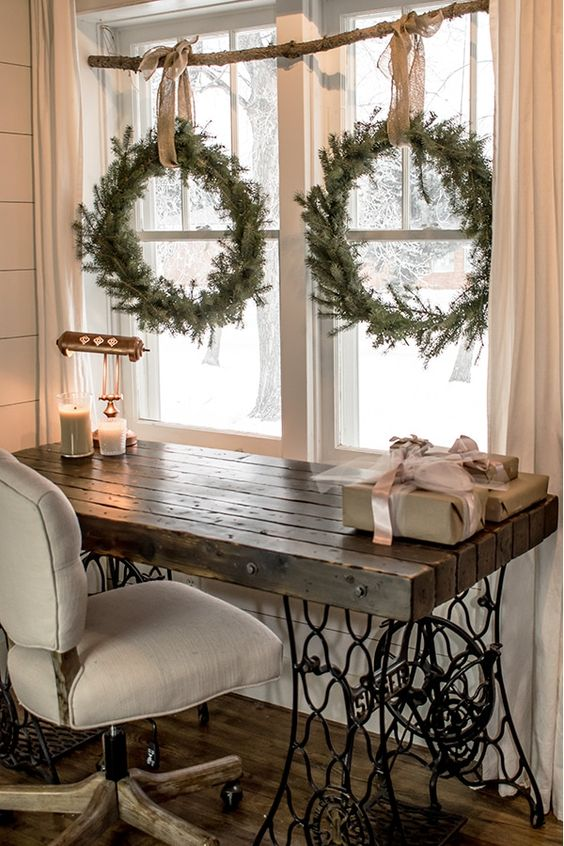 a branch with fir wreaths on burlap ribbons perfectly complete this vintage rustic space decor, they are easy to make