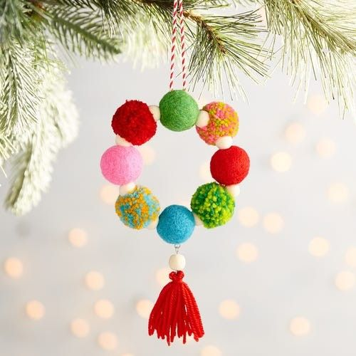 a colorful pompom and bead Christmas ornament with a tassel is a creative idea for the holidays