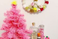 a colorful pink christmas tree decor with pompoms