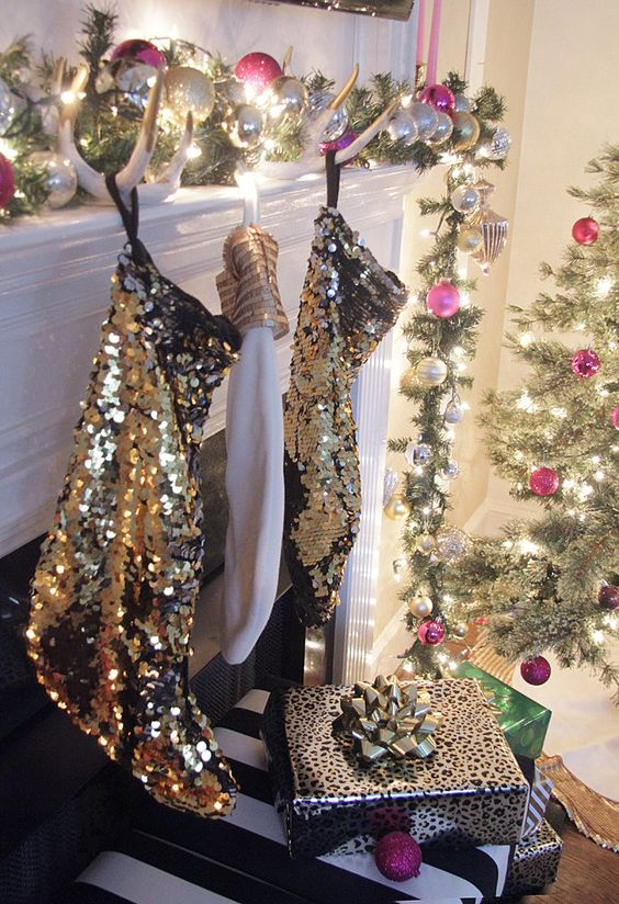 a glam Christmas mantel with pink and silver ornaments, antlers and gold sequin stockings and a matching Christmas tree