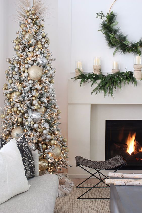 a glam Christmas tree - a flocked piece withan immense amount of silver and gold ornaments and lights will bring a shiny touch to the space