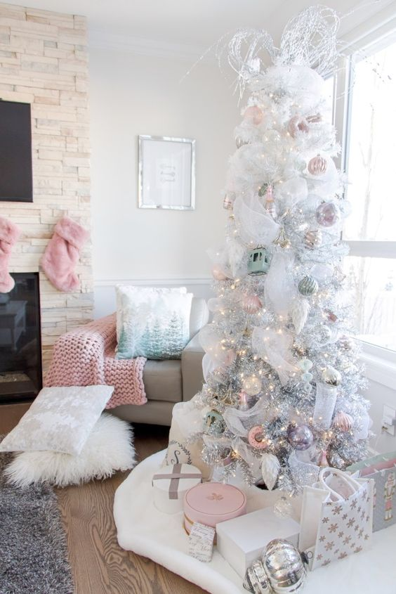a glam pastel Christmas tree - a white one, with pastel ornaments, lights and white twigs plus pastel pillows