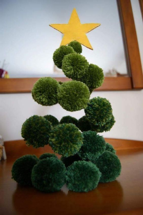 a green pompom swirl Christmas tree with a yellow star topper is a lovely and easy decoration for the holidays
