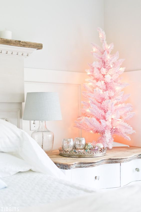 a pink tabletop Christmas tree with lights will add a little bit of glam and fun to your bedroom or some other room