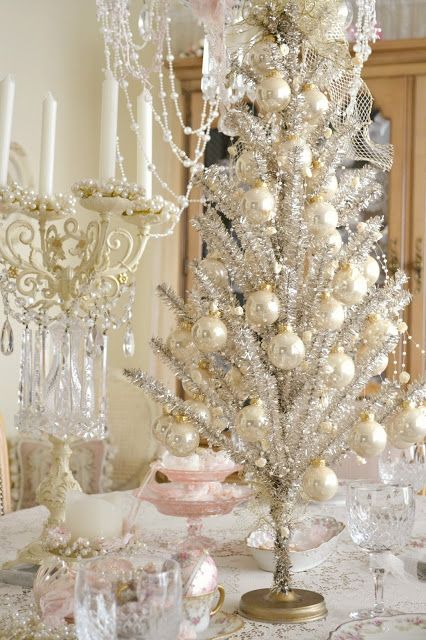 a refined vintage silver Christmas tree with pearly ornaments and lights is a very chic and very beautiful option to rock