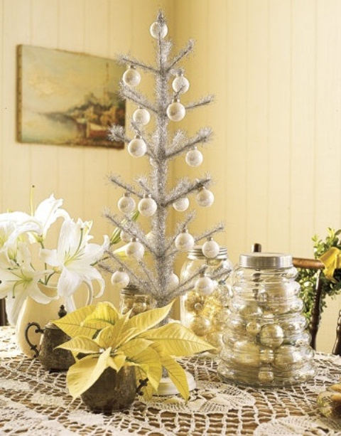 a silver tabletop Christmas tree with mother of pearl ornaments is a shiny and bright idea for holiday decor