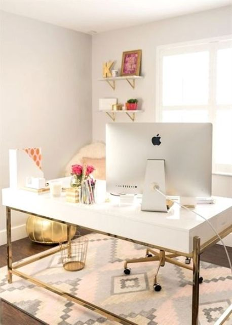 a small glam home office with a white desk, open shelves, gold touches for a shiny look and a glam feel in the space