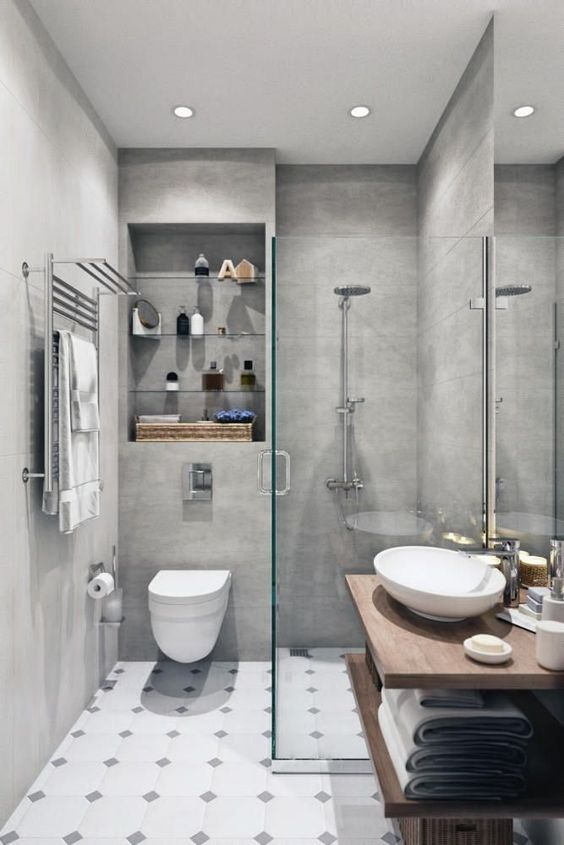 a small minimalist bathroom with concrete walls, a tiled floor, a floating open vanity and built-in shelves over the toilet