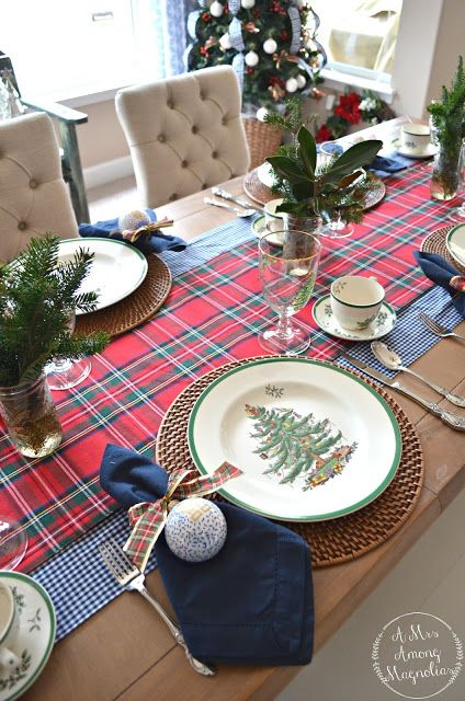 a stylish Christmas tablescape with rustic touches - a burlap runner, woven placemats, navy napkins and printed ornaments and foliage and fir branches