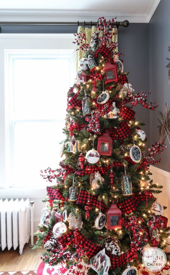 a super bright Christmas tree with lights, chalkboard and red lantern ornaments, bells, trees and berries plus plaid ribbons
