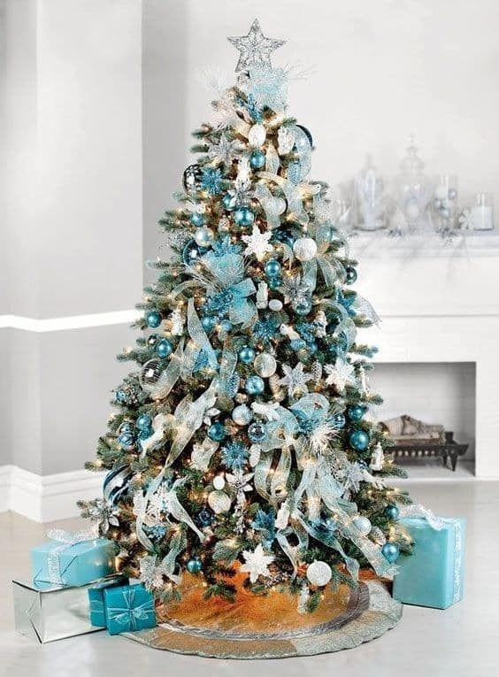 a tiffany blue Christmas tree with various ornaments, ribbons, lights and a silve star topper is a bold and chic idea
