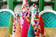 a tray with bold tinsel and colorful pompom Christmas trees is a fun decoration or centerpiece for the holidays