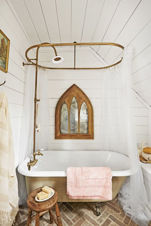 a cool farmhouse bathroom with vintage elements