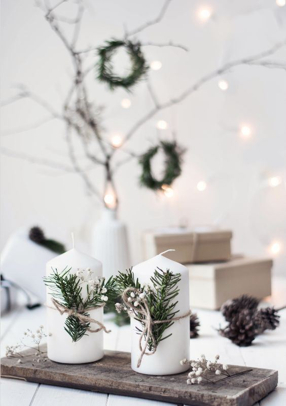 a wooden board, white candles, baby's breath, fir branches for lovely and chic Nordic Christmas decor