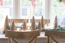 boxwood wreaths on striped red ribbons add catchiness and style to the space and make it look very wintry-like
