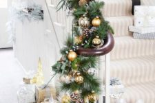 chic railing decor with fir garlands, white, sheer and gold ornaments, berries and greenery and some lights is wow