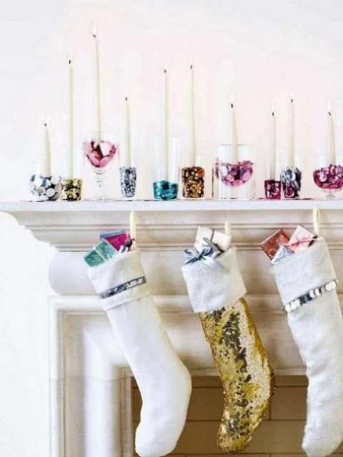 colorful sequin and glitter candle holders and stockings with sequins and mini gifts will help you create a glam feel in the space
