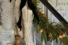 evergreen branches, vintage lights, black velvet bows, white knit stockings for beautiful and cozy vintage decor