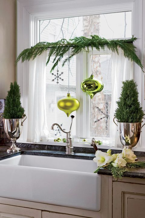 evergreens with neon green ornaments and a snowflake plus mini trees on both sides for bright Christmas decor