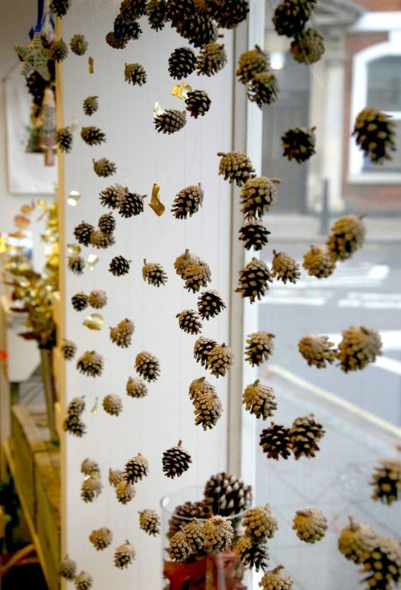 garlands of pinecones will turn your space into a woodland one, it will bring a wild and natural feel to the space